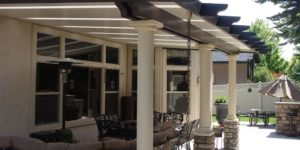 This beautiful patio cover has it all including skylights, double beams for a larger fuller look,  also stone and stucco posts, for a very high end feel.